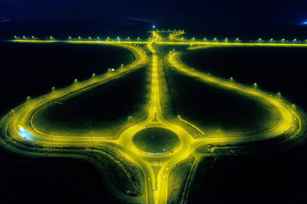 Lighted roads at night, aerial view from drone