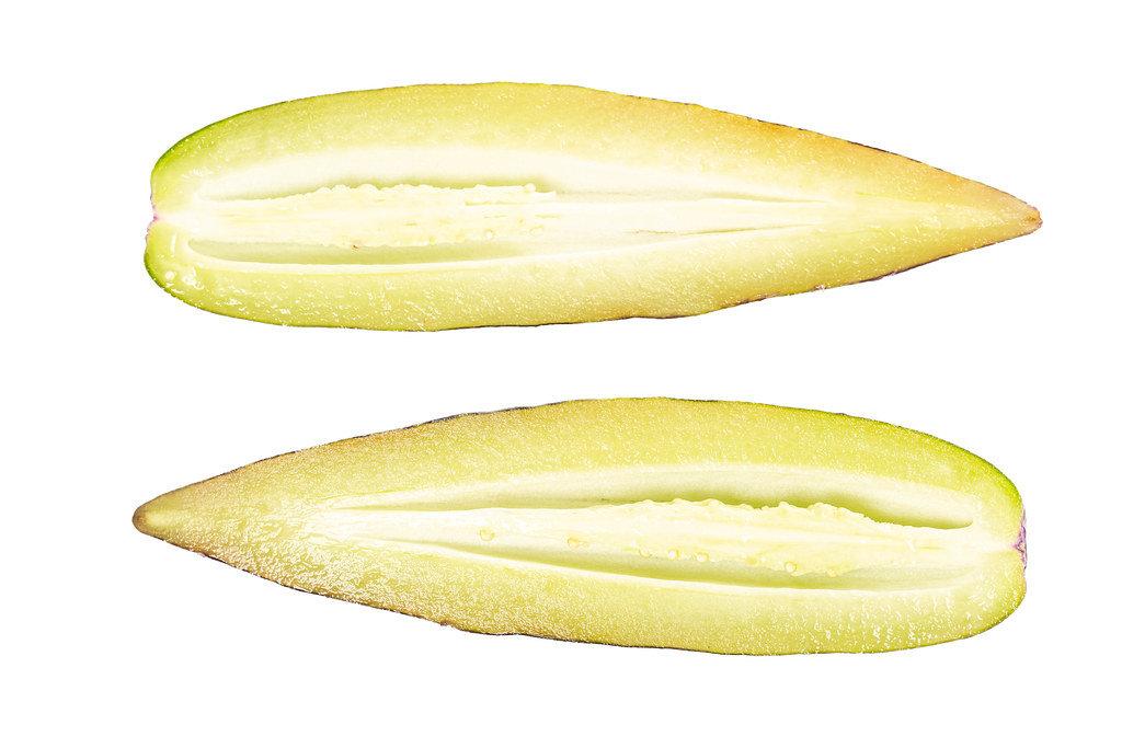 Halves of fresh ripe pepino, top view