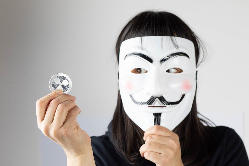 Woman with mask holding Ripple