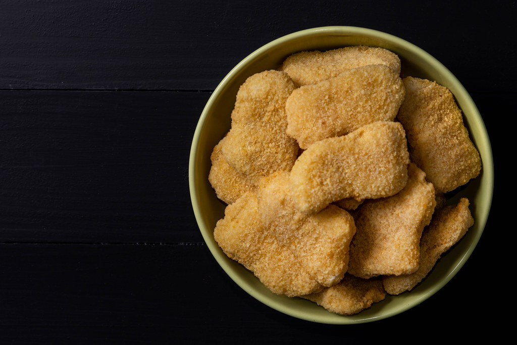Flat lay above Chicken Nuggets in the bowl