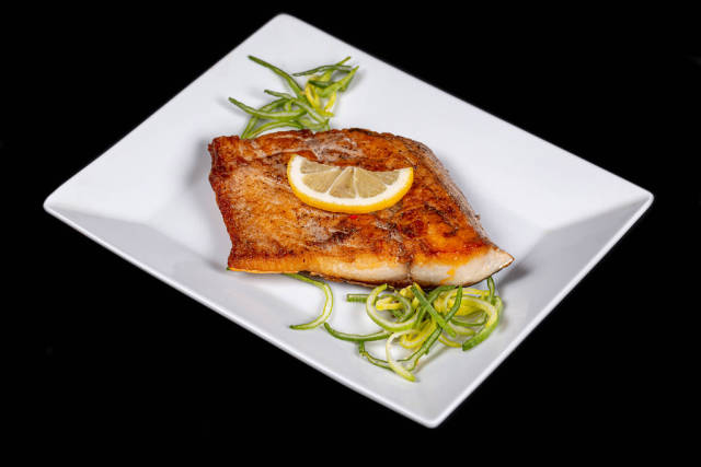 Delicious fried tuna fillet with lemon and leek