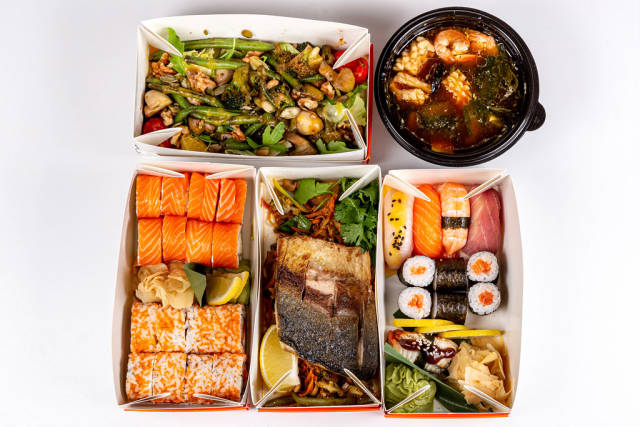 Top view, Asian cuisine dishes - miso soup, sushi, rolls, fish and salad