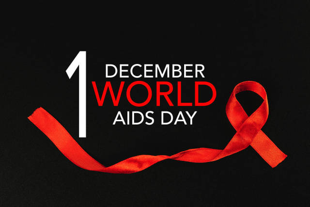 Black background with red ribbon and inscription World AIDS Day
