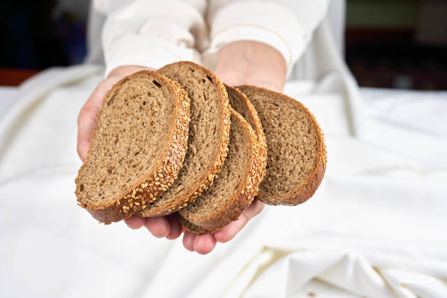 Woman holding in hands sourdough bread slices