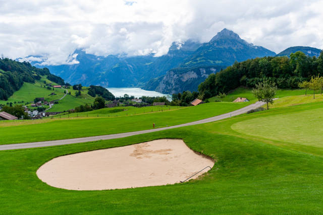Sand bunker of a golf club overlooking beautiful Swiss mountains and the lake Lucern