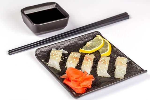 Sashimi set served with pickled ginger, lemon slices and soy sauce