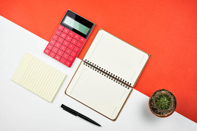 Office flat lay on split tones red and white background