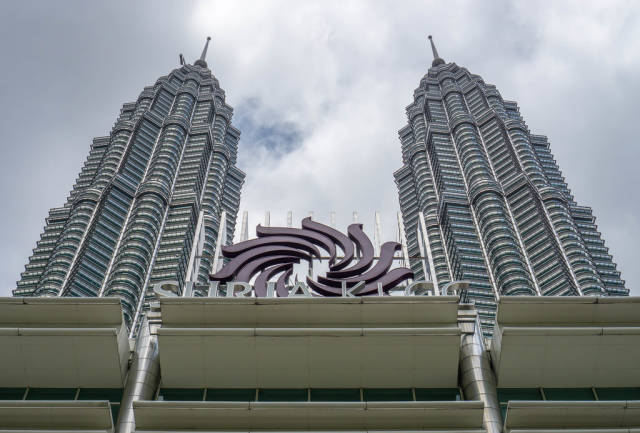 View of Petronas Twin Towers in front of the Entrance of Suria KLCC in Kuala Lumpur