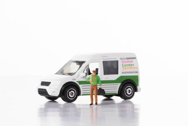 Man with delivery van on white background