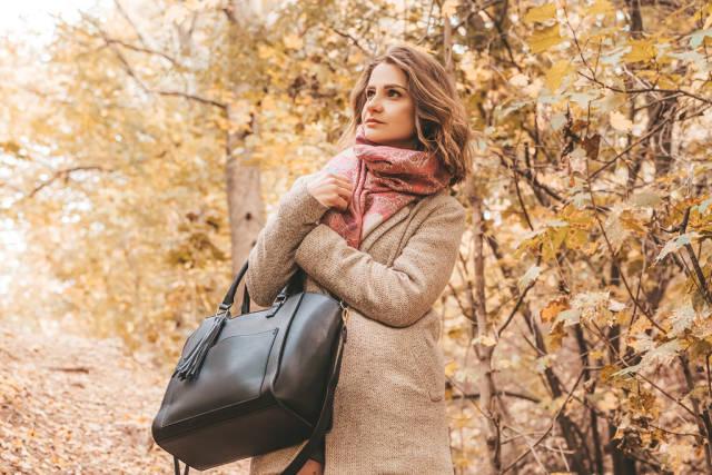 Woman in coat in autumn park