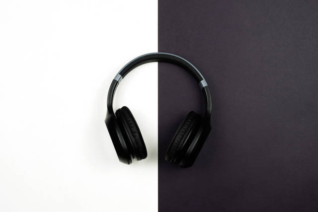 A wireless headphones on black and white split background
