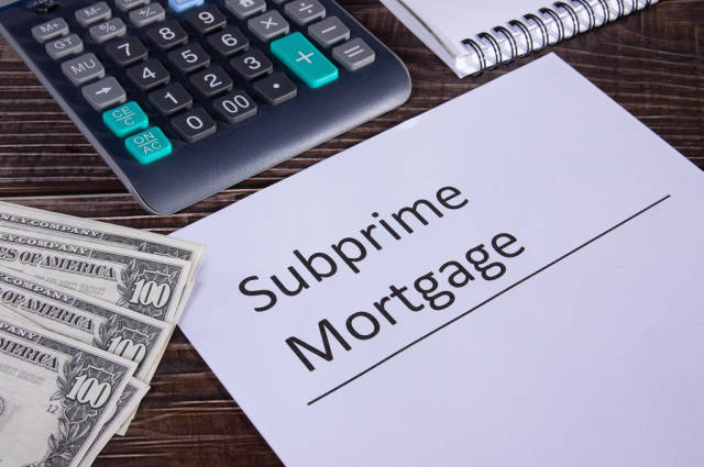 Subprime mortgage form, calculator and money