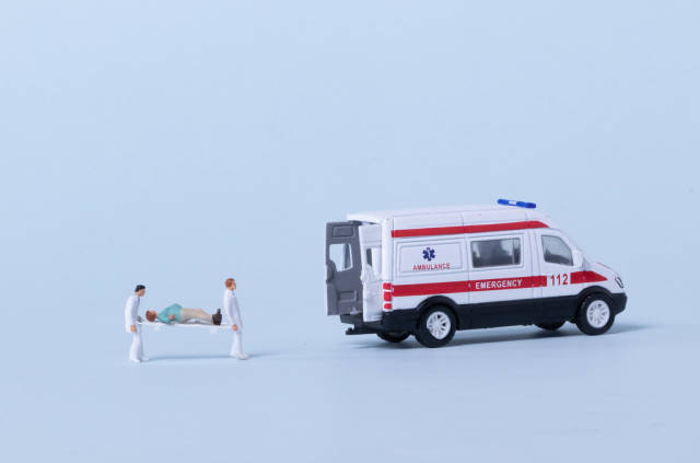 Ambulance team taking care of patient