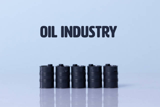 Oil barrels with Oil industry text