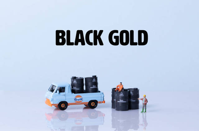 Truck and oil barrels with Black Gold text