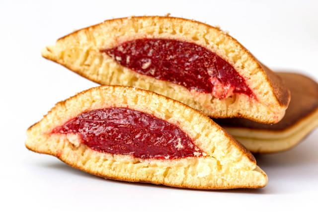 Close-up, halved pancakes with raspberry jam