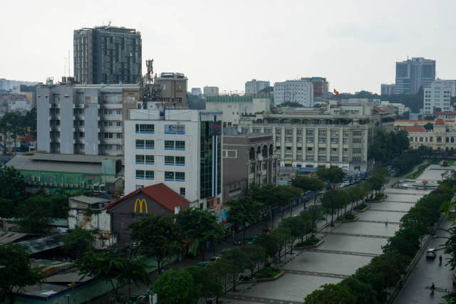 View of Nguyen Hue Walking Street and Peoples Committee of Ho Chi Minh City from The Cafe Apartment Building
