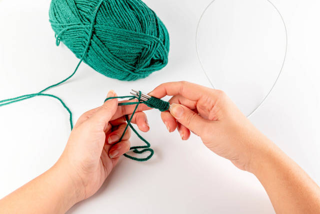 Womens hands and the process of knitting