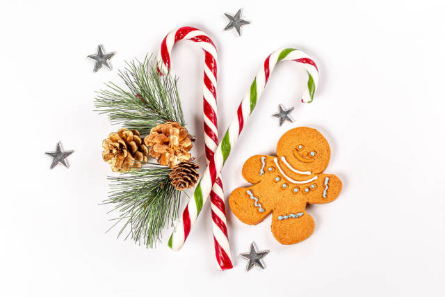 Lollipops cane and gingerbread man with christmas decor