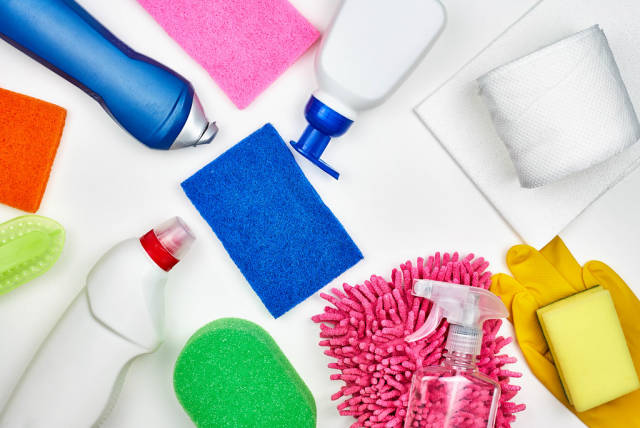Collection of cleaning supplies on white