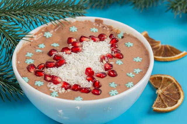 Close-up, coconut and pomegranate tree on oatmeal porridge with yogurt