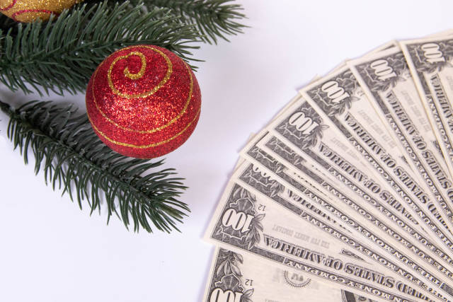 Christmas ornament and dollar banknotes on white background