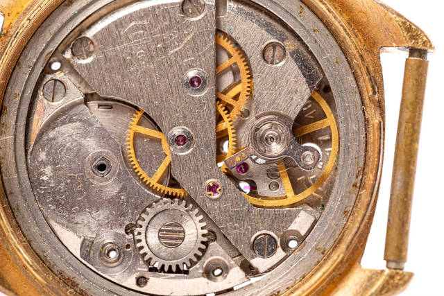 Close-up of old clock mechanism with gears