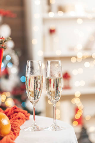 Glasses of champagne on the table against the background of the decorated living room