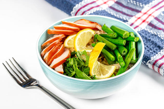 Oatmeal with chicken, spinach and broccolini