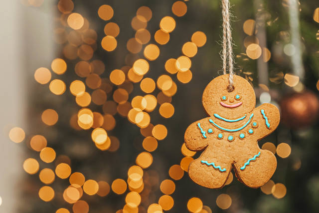 Gingerbread man on new year bokeh background