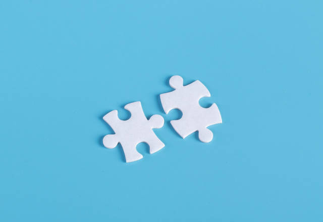 Puzzle pieces on blue background