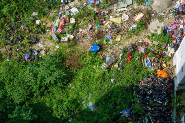 Top View Photo of Motorcyle Graveyard with different Trash around it in Ho Chi Minh City, Vietnam