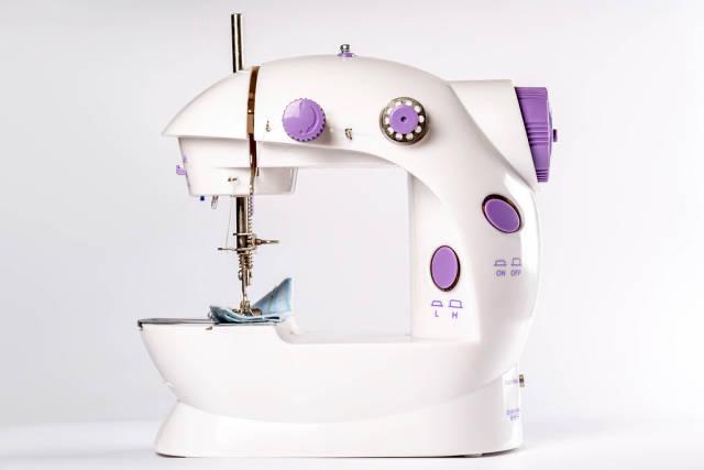 Sewing machine on white background