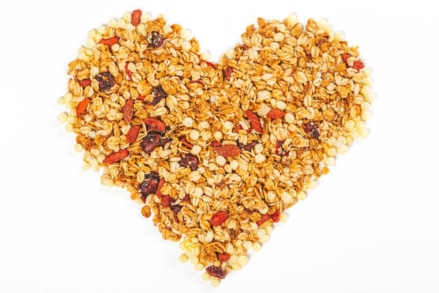 Heart made from dry oatmeal with dried berries and seeds