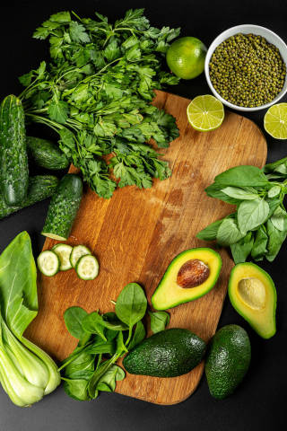 Fresh green vegetables and herbs, healthy food concept
