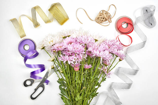 Florist preparing fresh spring bouquet