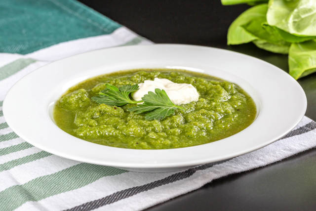 Dietary green cream soup, close up