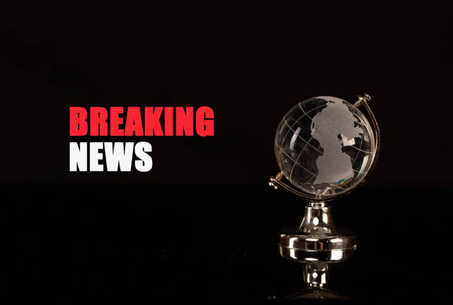 Globe and Breaking News text on black background