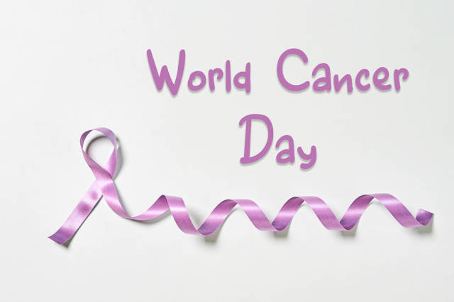A purple ribbon - symbol of World Cancer day