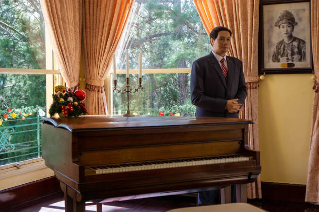 Wax Sculpture of Emperor Bao Dai of Nguyen Dynasty next to a Piano inside the Kings Palace in Da Lat, Vietnam