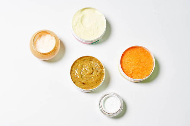 Five different cosmetic creams for face, hand and body