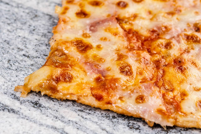 Slice of Fresh Pizza on the grey marble