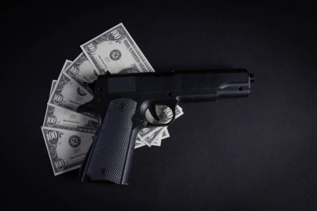 Heap of money and handgun
