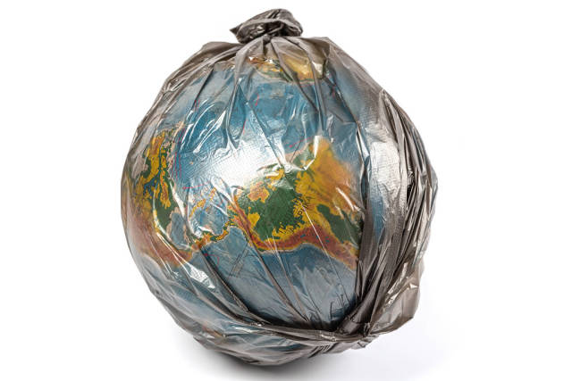 The globe in a black plastic bag, the concept of global pollution