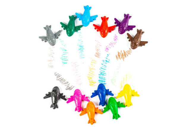 Top view, multi-colored set of crayons-airplanes on white
