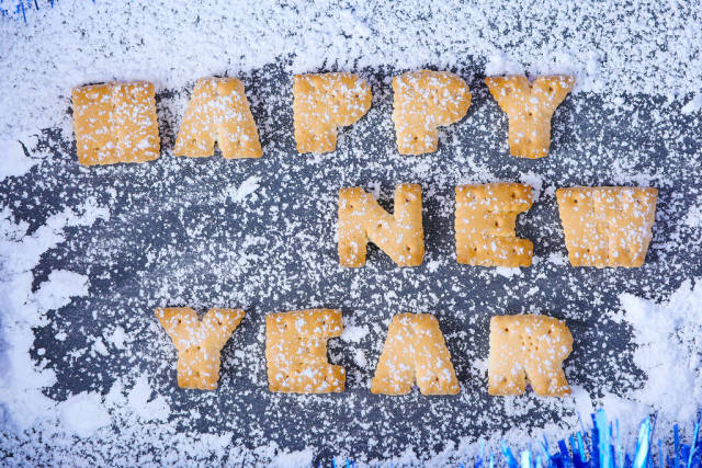Biscuit letters, snowing on Happy New Year message