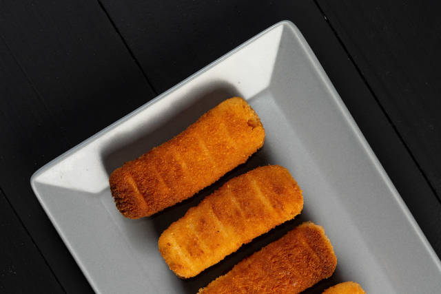 Fried Chicken Sticks on the square plate
