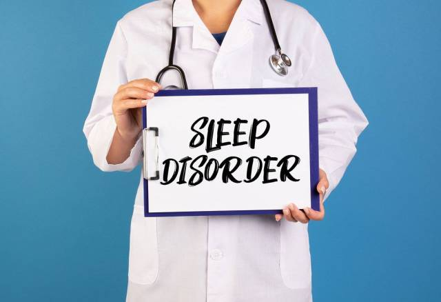 Doctor holding clipboard with Sleep disorder text