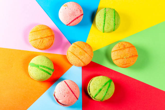 Colorful macaroon on a colored paper