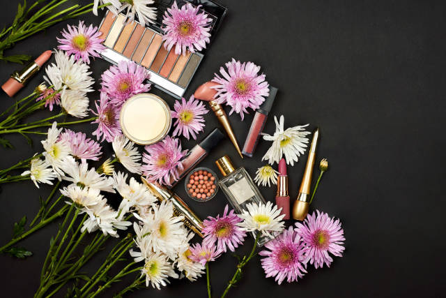 Colorful composition with female beauty accessories and spring flowers
